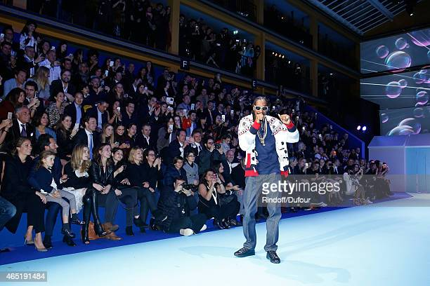 CoManager of Etam Group Laurent Milchior with his wife Stephanie and Natalia Vodianova watching Snoop Dogg who performs during the ETAM show as part...