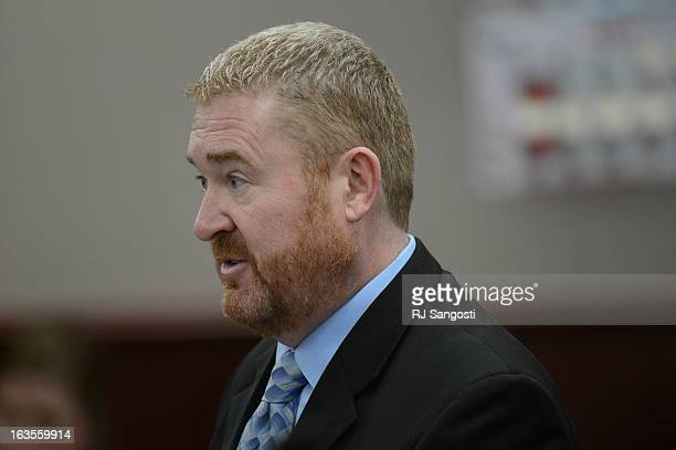 Defense attorney Daniel King speaks during the proceedings where District Court Judge William Sylvester entered a Not Guilty plea on behalf of Holmes...
