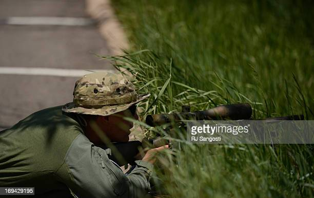 A police sniper keeps and eye on Thornton High School during a lock down May 24 2013 Police were looking for someone inside the school with a gun No...