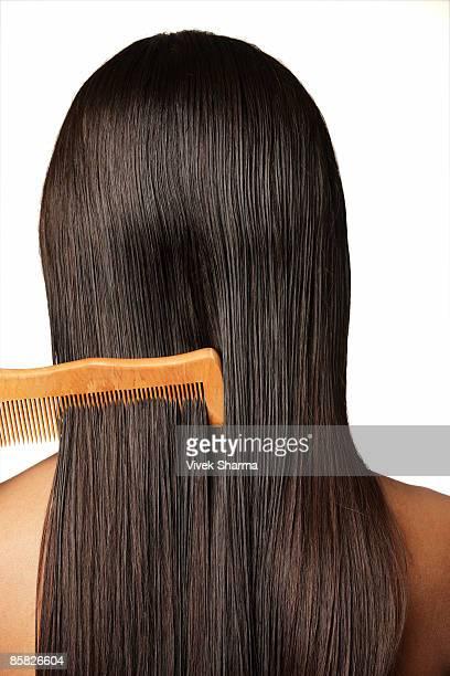 comb through long dark hair
