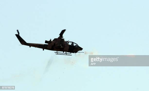 A combat Cobra helicopter fires during an Efes2009 Military Exercise in Izmir on May 26 2009 Turkish Prime minister Recep Tayyip Erdogan and Chief of...
