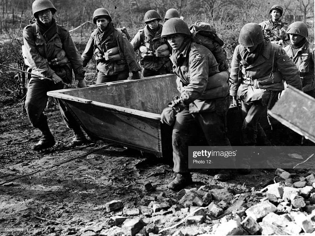 combat engineers of the 84th division 9th us army drag their assault boat to