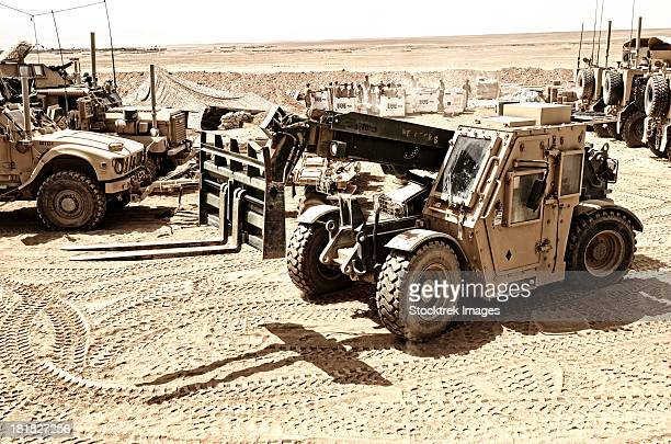 a combat logistics battalion multi-mission vehicle unloads supplies. - battalion stock pictures, royalty-free photos & images
