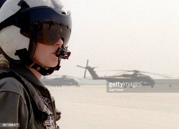 LSCombat PilotCranialGF3/28/96Combat Pilot/Tarmac–First Lt Deal outfitted with her 'cranial' crash helmet to squelch out sound and buffer bumps gets...