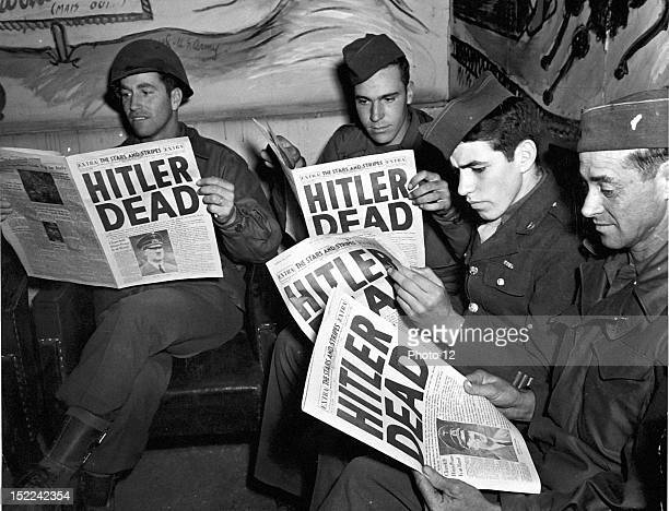 US combat soldiers on pass in Paris read of the death of Adolf Hitler in an 'Extra' edition of Stars and Stripes