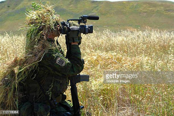 a combat videographer practices evasion techniques. - photojournalist stock pictures, royalty-free photos & images