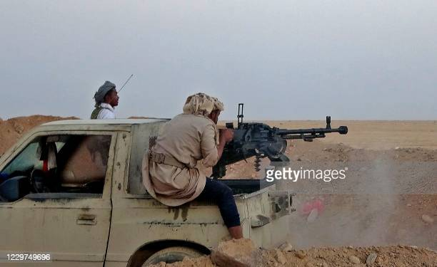 Combatant mans a heavy machine gun as forces loyal to Yemen's Saudi-backed government clash with Huthi rebel fighters around the strategic...
