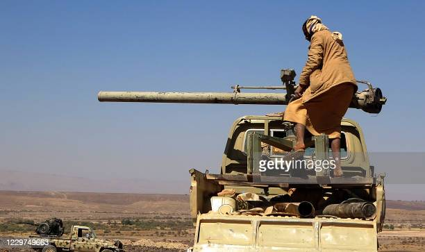 Combatant mans a recoilless gun as forces loyal to Yemen's Saudi-backed government clash with Huthi rebel fighters around the strategic...