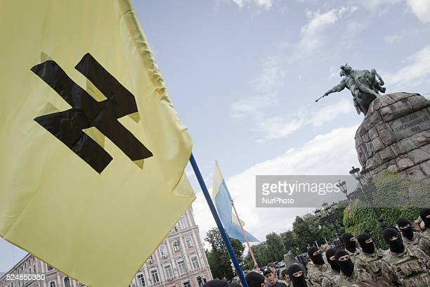 Combatants of Ukrainian Azov battalion stay near Bohdan Khmelnytsky monument before they were sent on a theater of ATO.