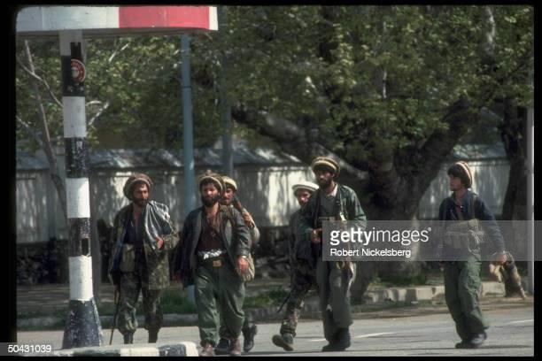 combatants on move in postNajibullah internecine war engaging forces of interim govtallied Dostam's Uzbek militia Hekmatyar mujahedin