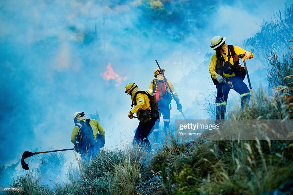 Combating the flames : Stock Photo