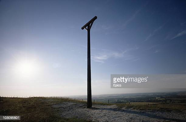 Combe Gibbet stands atop Gallows Hill where it was erected in 1676 for the hanging of George Broomham and Dorothy Newman near the village of Combe...