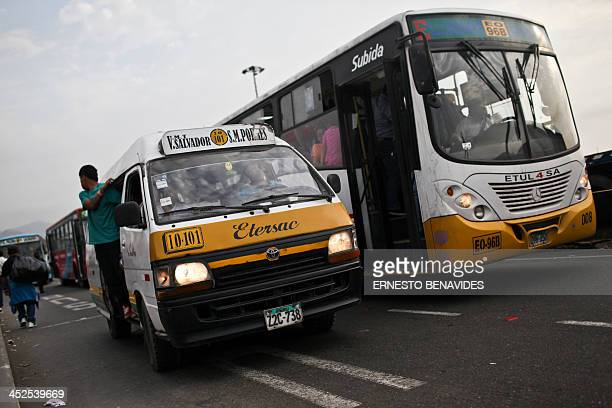 A combi minibus await amid the traffic in Lima on November 29 2013 Lima's combis drive along the streets of Lima at high speed do not respect the red...