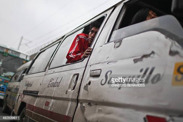 A combi minibus conductor calls for passengers at a main avenue in Lima on November 29 2013 Lima's combis drive along the streets of Lima at high...