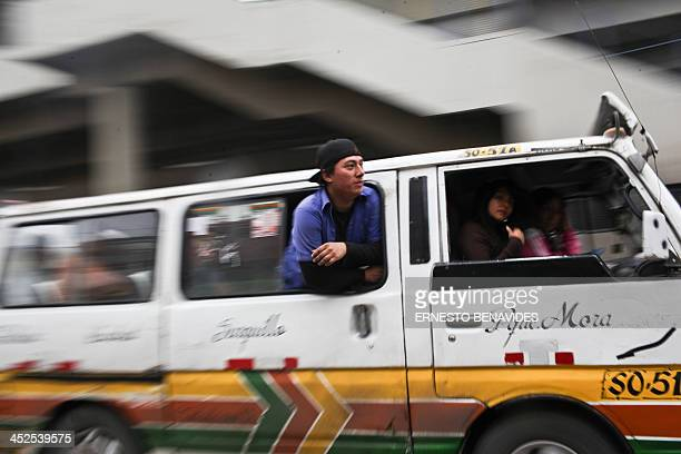 A combi minibus conductor calls for passengers in a main avenue in Lima on November 29 2013 Lima's combis drive along the streets of Lima at high...