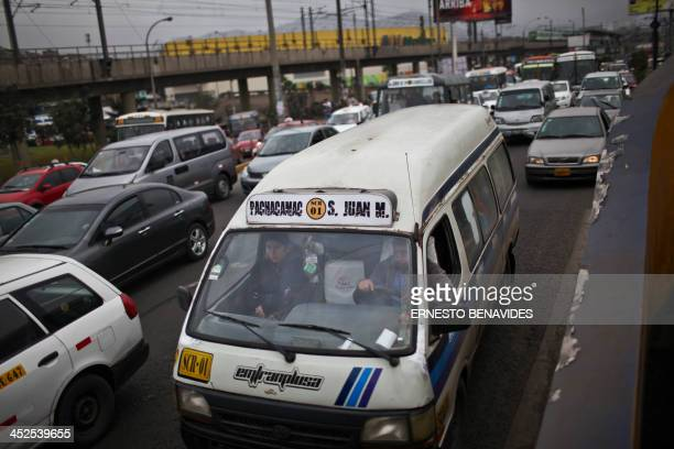 A combi minibus drives amid heavy traffic in Lima on November 29 2013 Lima's combis drive along the streets of Lima at high speed do not respect the...