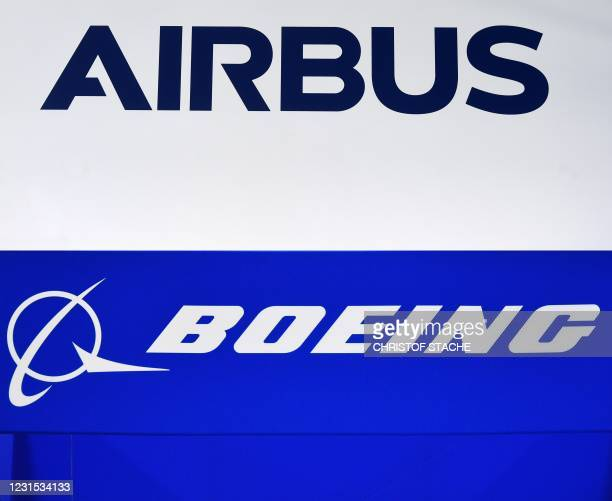 Combination made on March 3, 2021 shows a picture of the company sign of Airbus made in Donauwoerth, southern Germany, on July 20, 2020 and a photo...