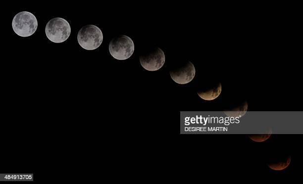 A combination of 10 pictures shows the moon in different stages of a total lunar eclipse seen from the Spanish Canary island of Tenerife on April 15...