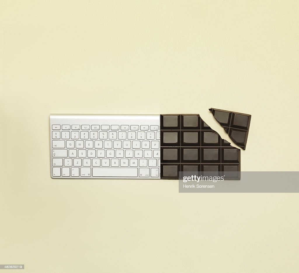 Combination of a bar of chocolate and a keyboard : Stock Photo