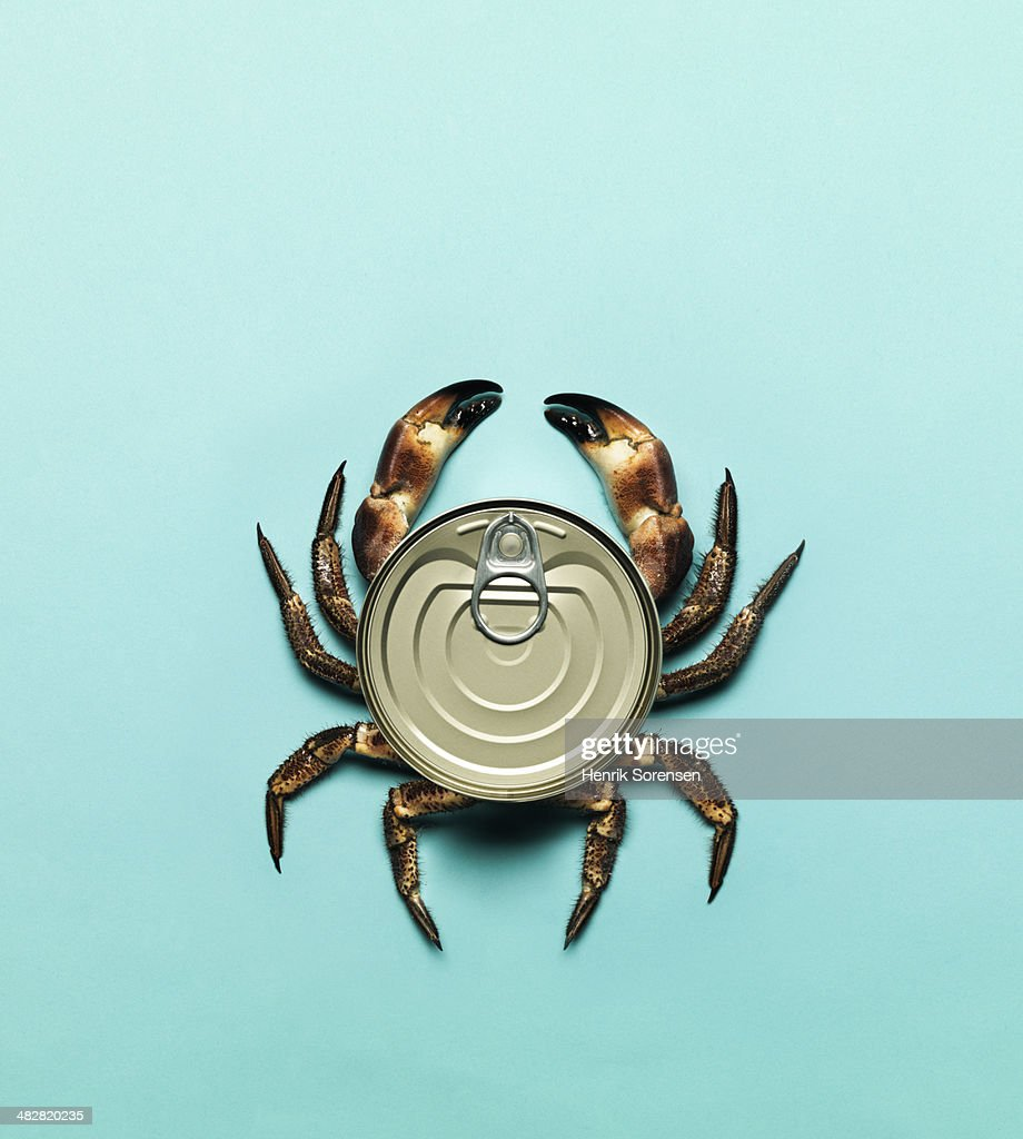 Combination of a can and a crab : Stock Photo