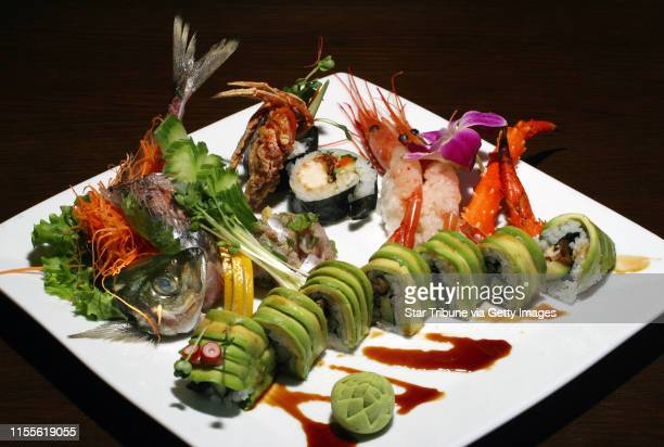 Combination of items,clockwise from upper left: 1/Aji Tatashi, 2/ soft shell crab, 3/ Ama Ebi and king crab legs, 4/Caterpillar roll. GENERAL...