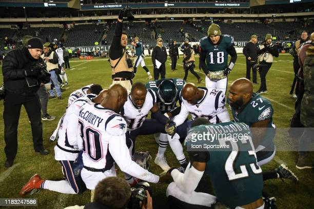 A combination of Philadelphia Eagles and Patriots pray after the game between the New England Patriots and the Philadelphia Eagles on November 17...