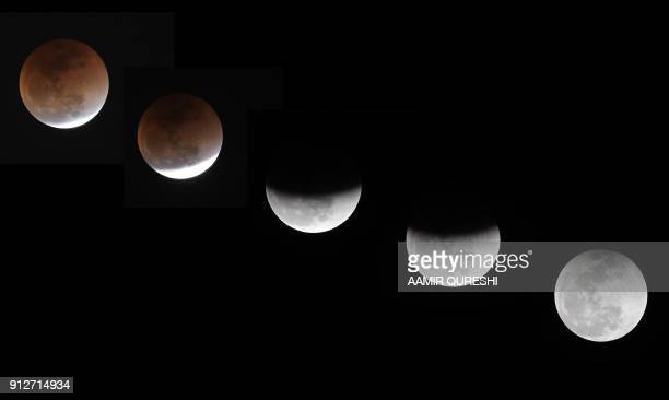 A combination of pictures taken and created on January 31 2018 in Islamabad shows the moon during a lunar eclipse referred to as the 'super blue...