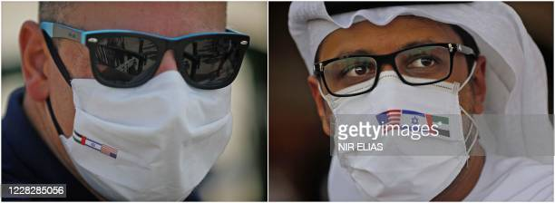 Combination picture shows a man in Israel and another in the United Arab Emirates, both wearing protective face masks bearing the American, Israeli...