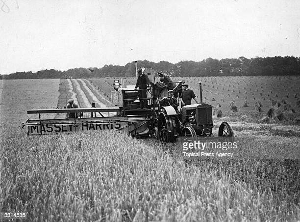 A combine harvester cutting and threshing the barley in one action