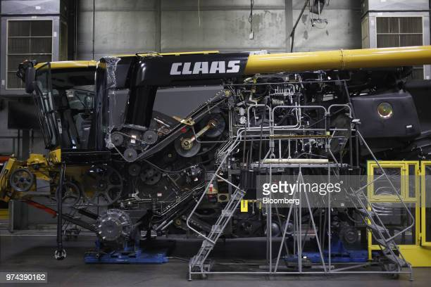 A combine harvester sits during assembly at the CLAAS of America Inc production facility in Omaha Nebraska US on Wednesday June 6 2018 The Federal...