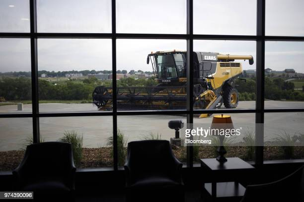 A combine harvester sits on display outside the CLAAS of America Inc production facility in Omaha Nebraska US on Wednesday June 6 2018 The Federal...