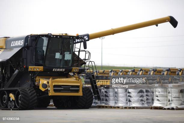 A combine harvester sits parked outside the CLAAS of America Inc production facility in Omaha Nebraska US on Wednesday June 6 2018 The Federal...