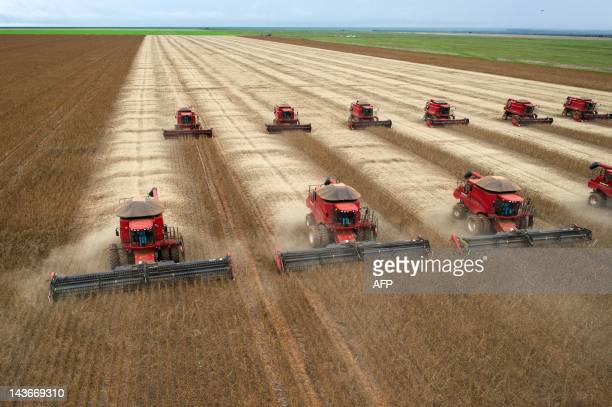 Combine harvesters crop soybeans during a demonstration for the press in Campo Novo do Parecis about 400km northwest from the capital city of Cuiaba...