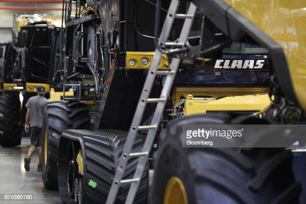 Combine harvesters sit on the assembly line at the CLAAS of America Inc production facility in Omaha Nebraska US on Wednesday June 6 2018 The Federal...