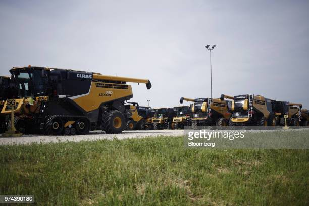 Combine harvesters sit parked before shipment at the CLAAS of America Inc production facility in Omaha Nebraska US on Wednesday June 6 2018 The...