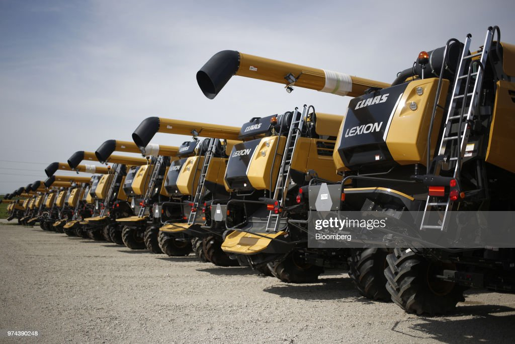 Combine harvesters sit parked before shipment at the CLAAS of America Inc. production facility in Omaha, Nebraska, U.S., on Wednesday, June 6, 2018. The Federal Reserve is scheduled to release industrial production figures on June 15. Photographer: Luke Sharrett/Bloomberg via Getty Images