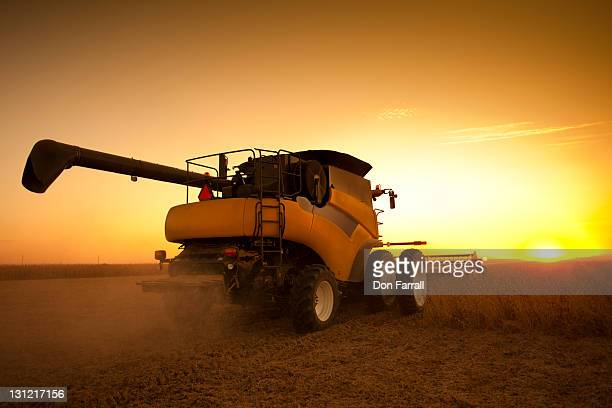 combine harvesting soybeans at dusk - soybean harvest stock pictures, royalty-free photos & images