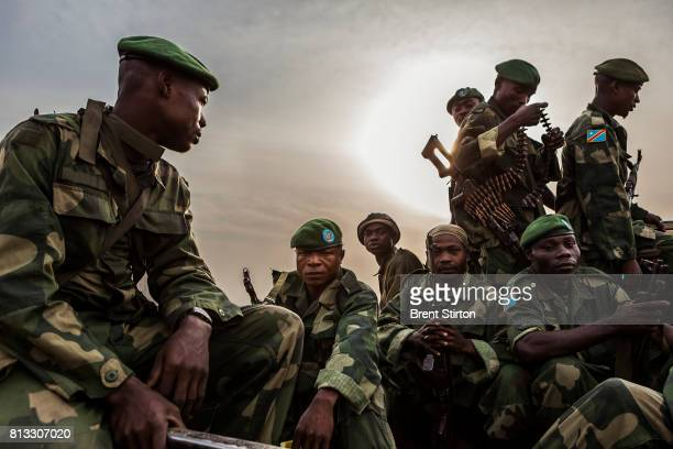 A combined ICCN conservation Ranger force and FARDC Congolese Army soldiers patrol both the road and inland in the Virunga National Park at Rwindi...