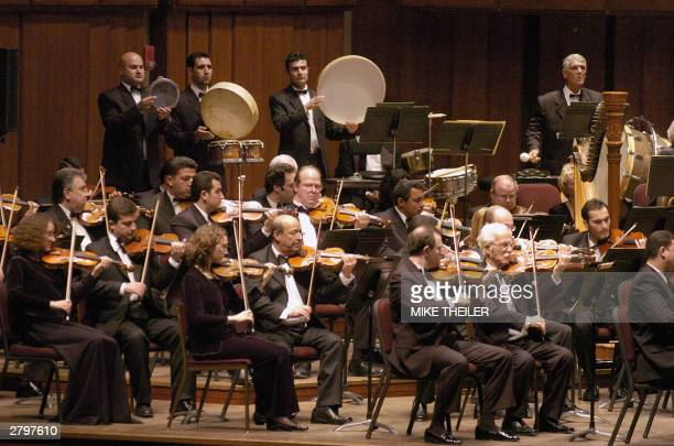 A combined National Symphony Orchestra and the Iraqi National Symphony Orchestra in performance 9 December 2003 at the Kennedy Center in Washington...