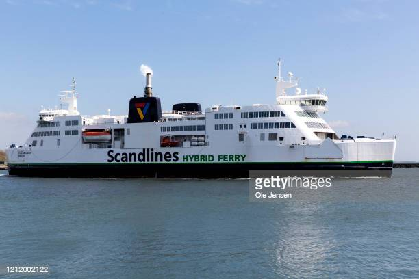 Combined passenger and car ferry leaves Rødby harbor heading for Puttgarden in Northern Germany on May 6, 2020 in Rodby, Denmark. The ferry...