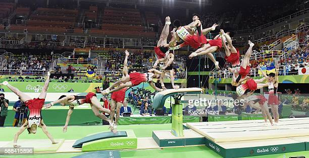 Combined photo shows Kohei Uchimura of Japan performing the Li Xiaopeng technique on the pommel horse during the artistic gymnastics men's individual...