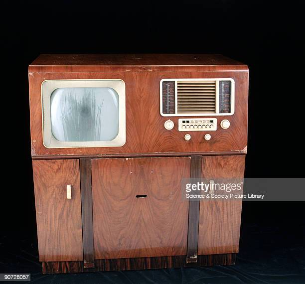 Combined six inch television and radio mounted on a wooden sideboard which would have been the main focus of the family sitting room Television...