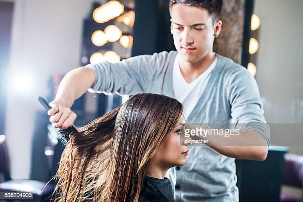 Combing a hair.