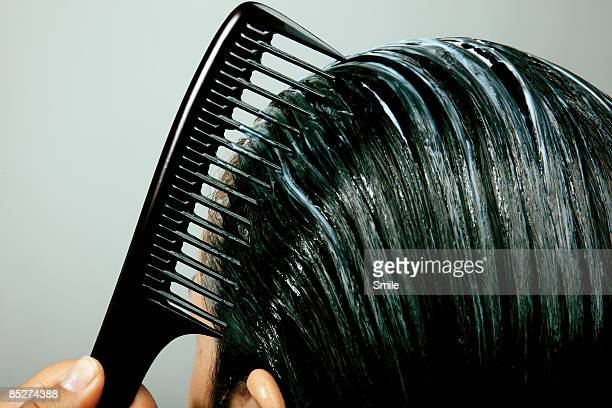 combing conditioner through hair, close up - penteando imagens e fotografias de stock