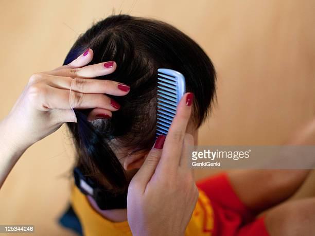 Combing girl hair