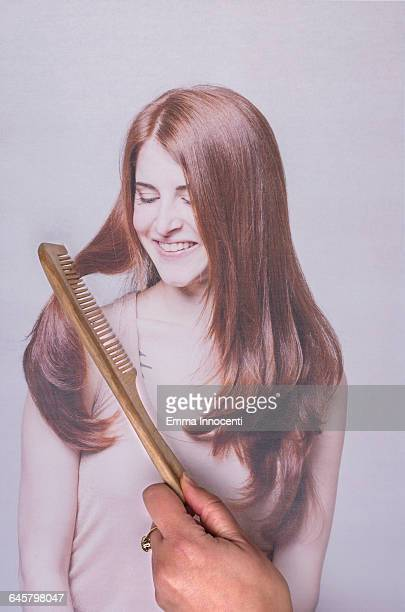 Combing hair of a young woman