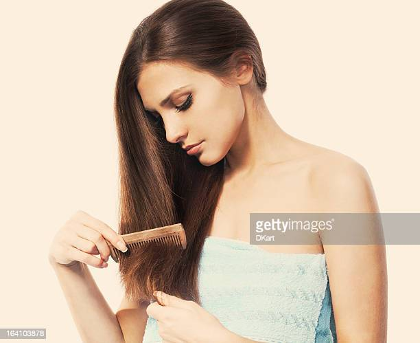 combing  hair - hair loss stock pictures, royalty-free photos & images
