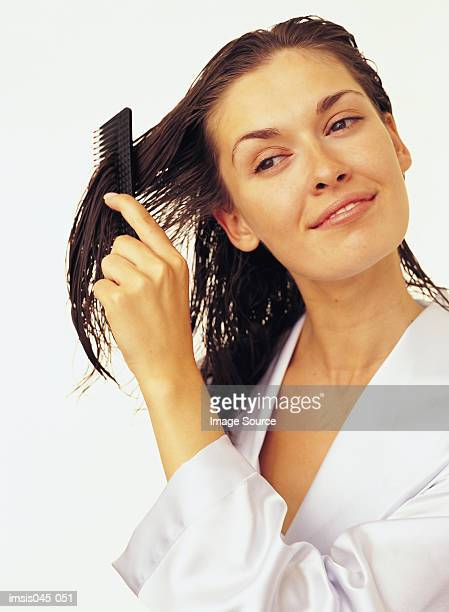 combing hair - wet hair stock pictures, royalty-free photos & images