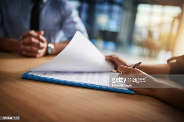 combing through the fine print - strategy stock photos and pictures