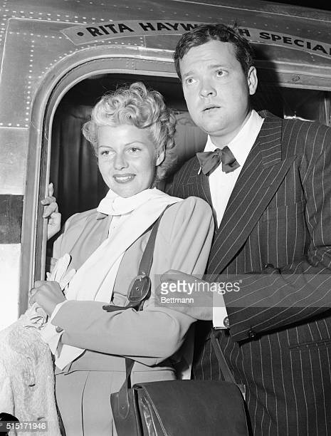 Combining business and pleasure actress Rita Hayworth and her husband Orson Welles board the Rita Hayworth Special at Burbank for a flight to...
